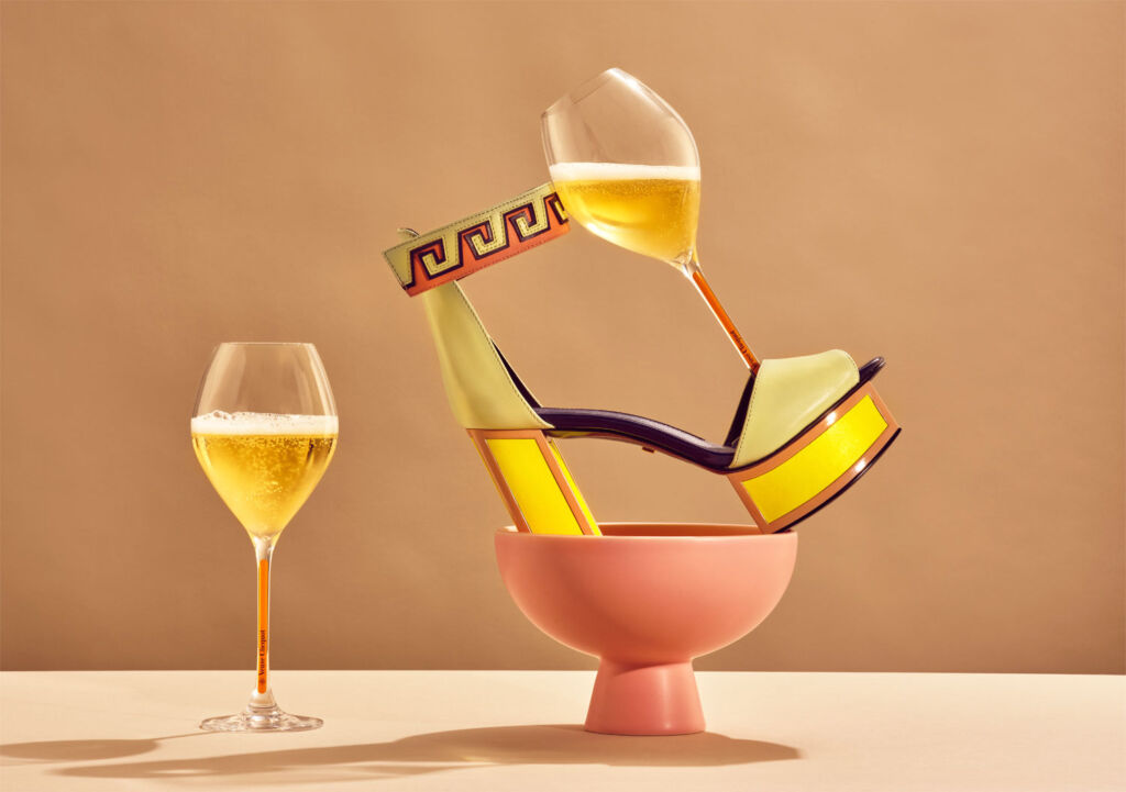 Kat Maconie shoes with a glass of Veuve Clicquot
