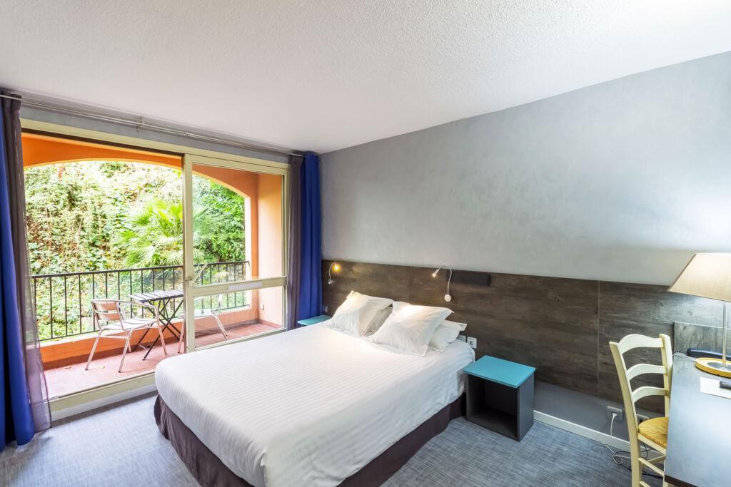 A bedroom suite at Hôtel Napoleon in La Turbie Monaco
