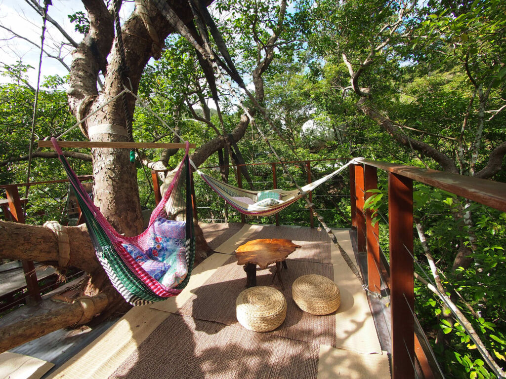 The outside seating are with hammock with one of the rooms