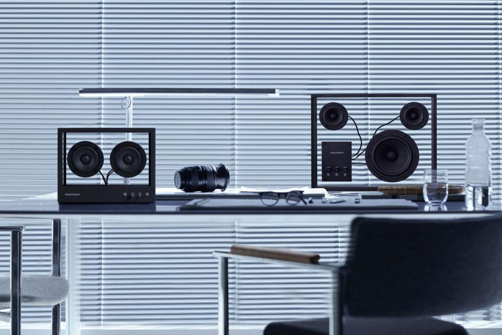 Transparent Matte Black Speakers on a desk