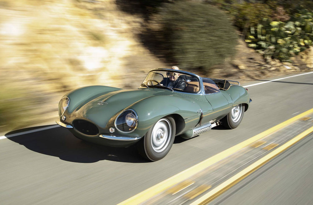 Vintage Jaguar being driven on the open road