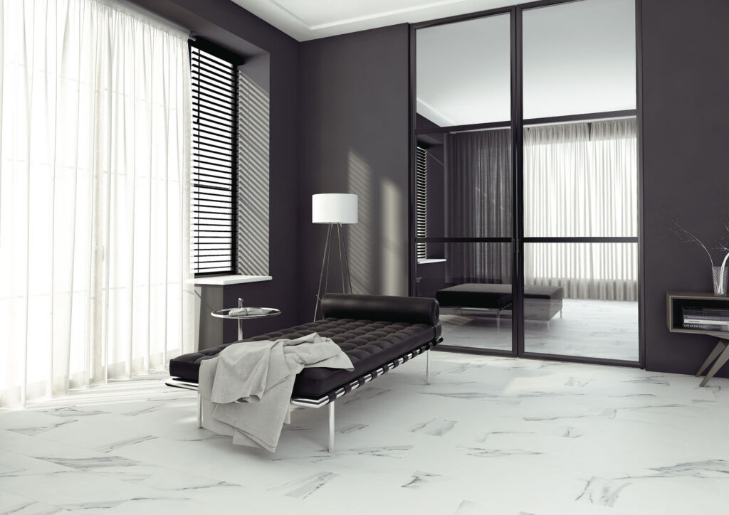A living area in black and white with marble tiles