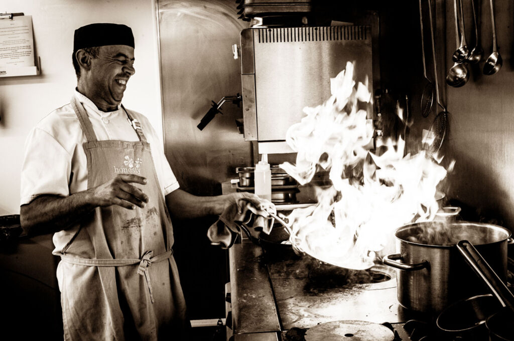 Chef flambéing in the pub kitchen