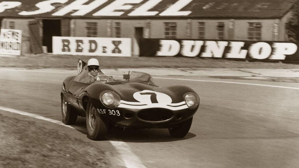 D Type Jaguar racing on a circuit