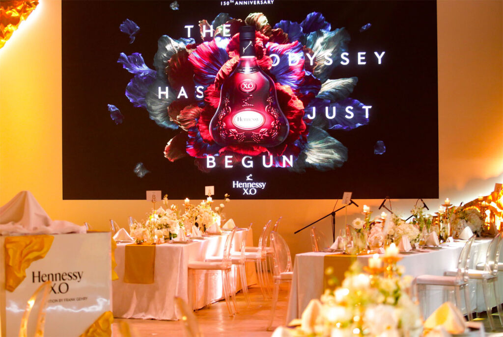 The beautifully laid out tables bedecked with roses at the celebratory dinner