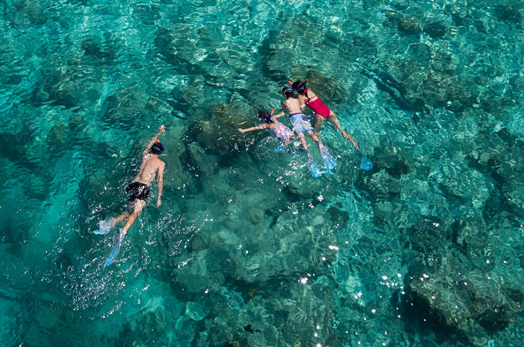 Family snorkelling in the Maldives