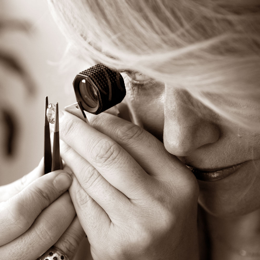 Gemologist Kate McCoy inspecting a gemstone