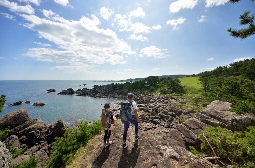 Young couple walking along the Hachinohe seashore