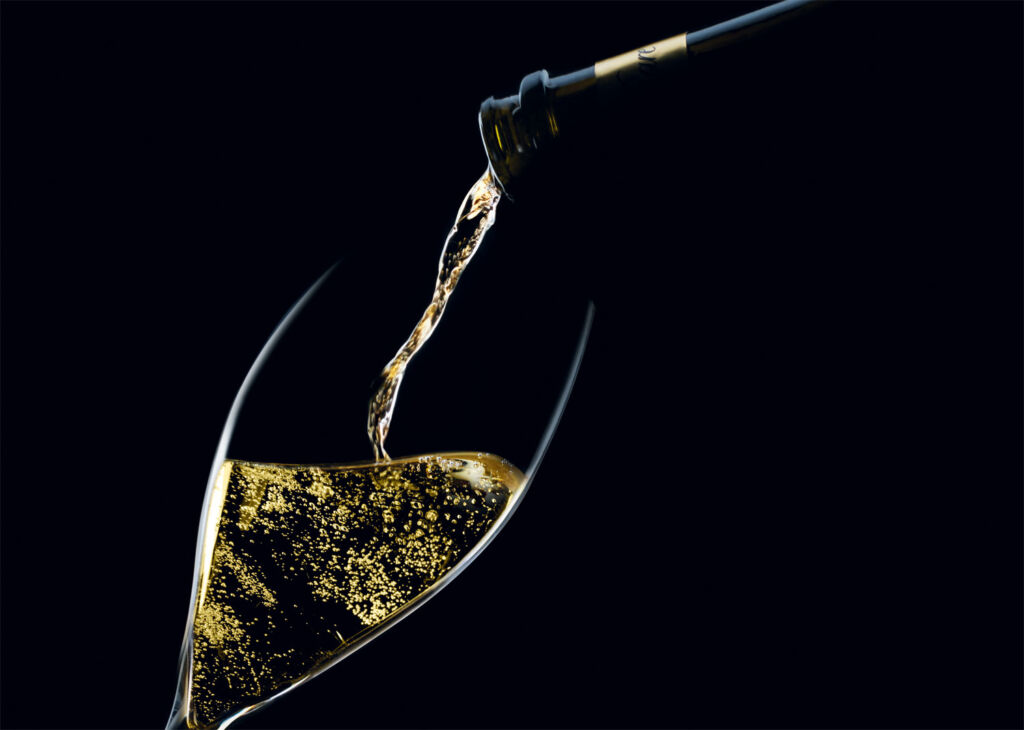 Rare champagne being poured from a bottle into a glass