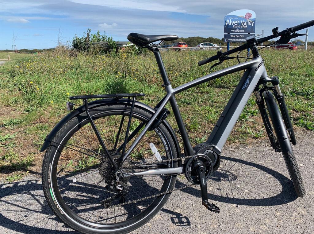 Triumph's Trekker GT e-Cycle at the entrance to Alver Park