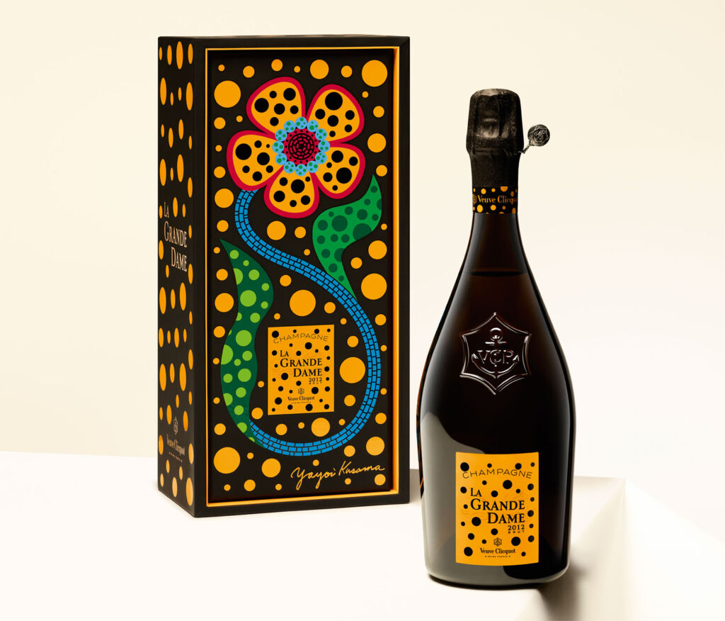 The La Grande Dame bottle next to its box