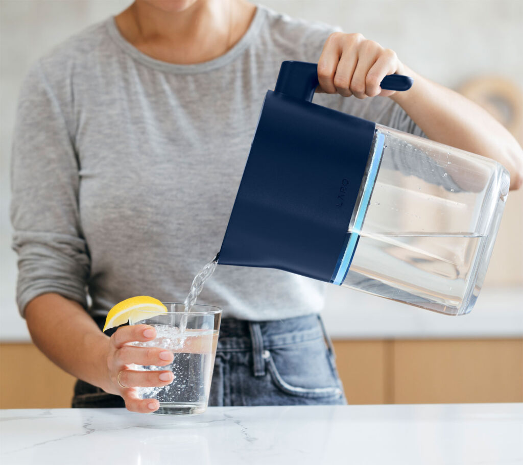 Woman pouring with a LARQ Blue Pitcher