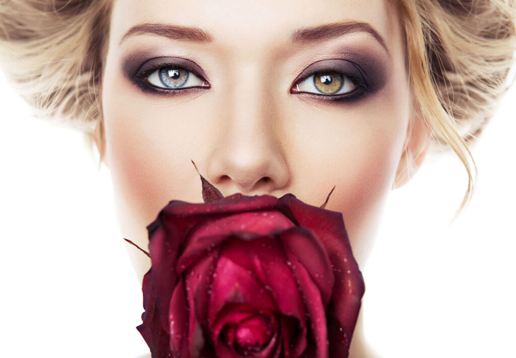 Woman smelling the scent of a rose