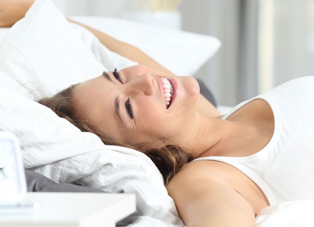 Woman waking up without a care in the world