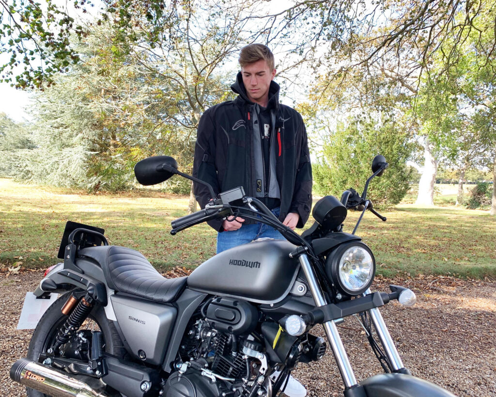 Young man admiring the Sinnis Hoodlum 125cc