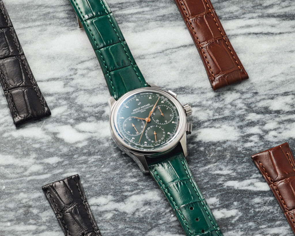 The timepiece with its choice of three leather straps (brown, black and green).