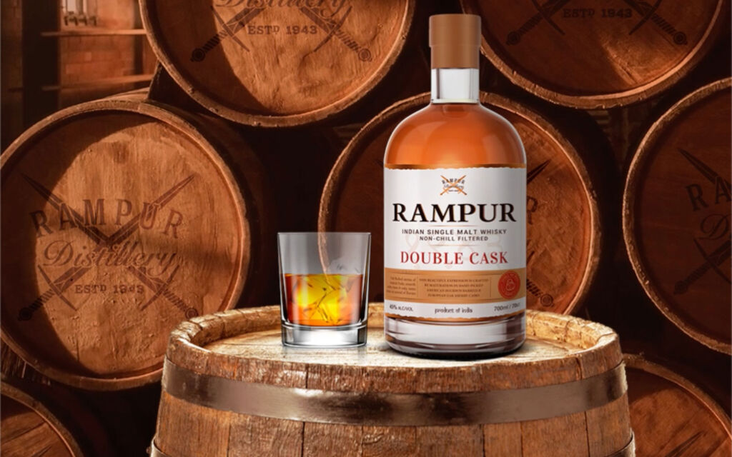 Bottle of Rampur Double Cask on a barrel