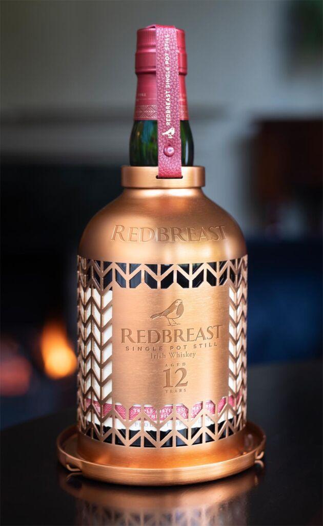 Bottle of Redbreast Whiskey inside the Bird Feeder