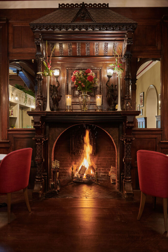 A roaring log fire is the ideal way to greet guests in the colder months