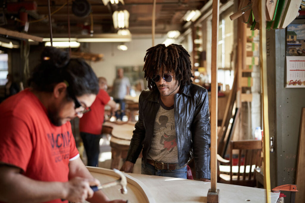 Lenny Kravitz working closely with one of the Steinway & Sons artisans