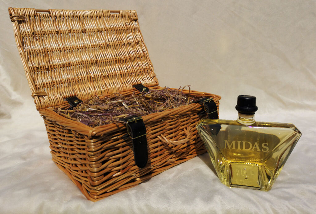 A bottle of Midas Mead with its wicker basket
