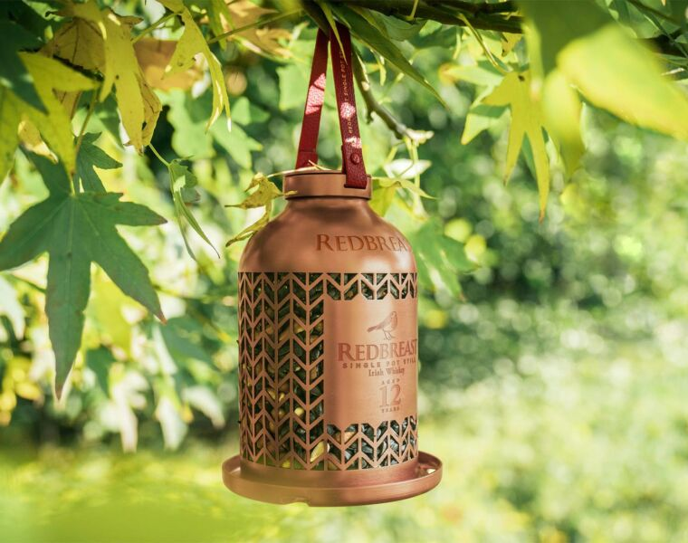 The limited edition bird feeded from Redbreast and Birdlife hanging from a tree