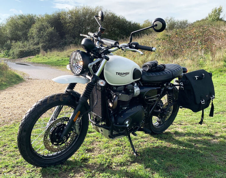 The Street Scrambler parked by an English beach