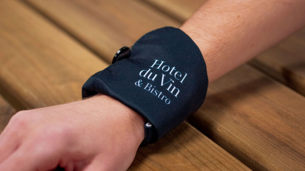 The Facelet being worn on the wrist