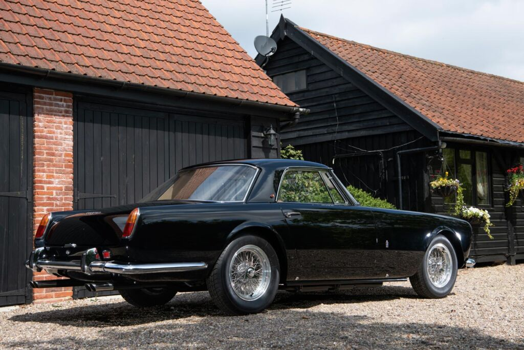 A classic black Ferrari at an English Countryhouse