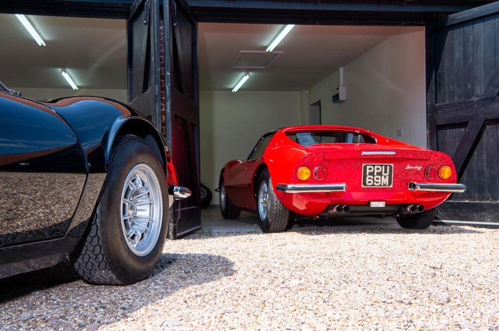 A red Ferrari Dino in a garage