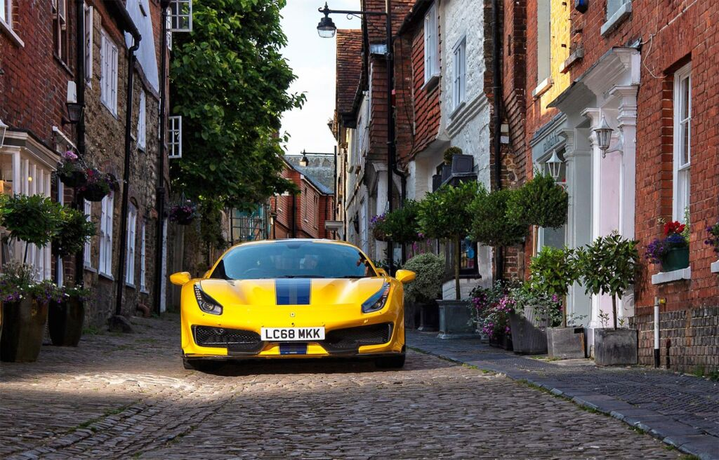A yellow Ferrari diving through the cobbled streets of Petworth