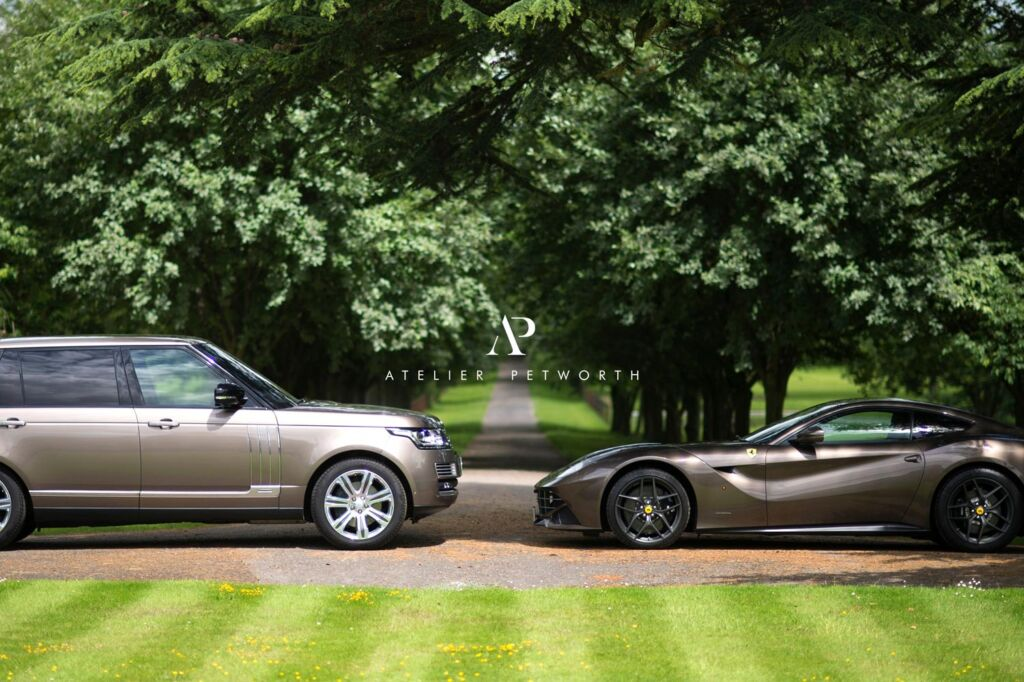A Range Rover and a Ferrari at Petworth Park in Sussex