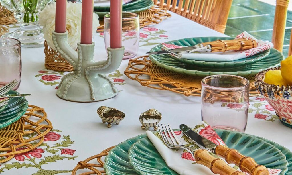 A beautiful collection of handmade tableware laid out on a table