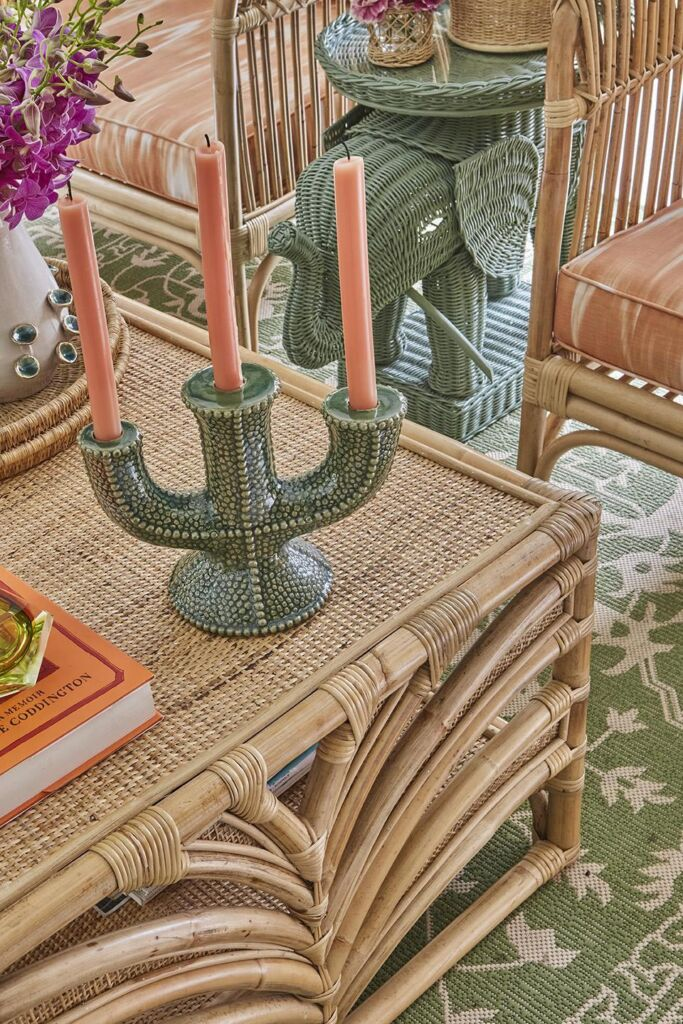 A coral-inspired candelabra and a ratten elephant shaped side table