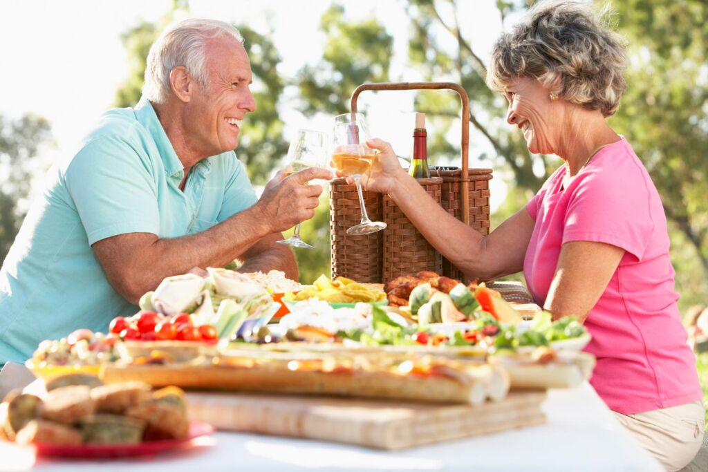 Couple in their 70s enjoying a meal