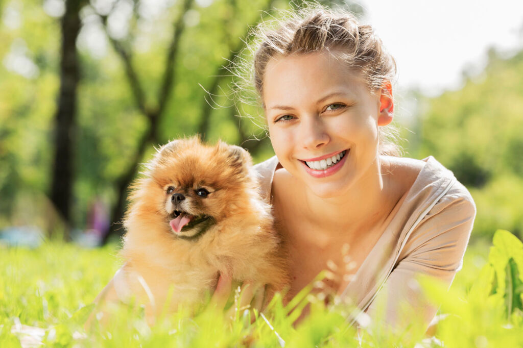 A blonde haired woman with her dog