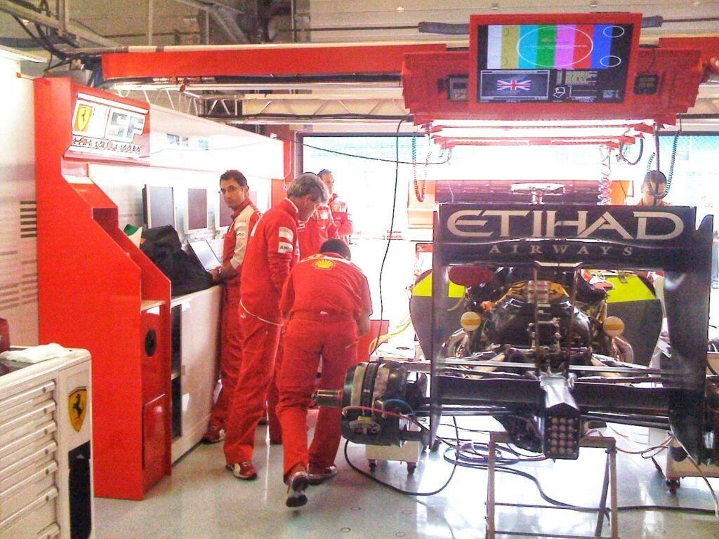 The Ferrari team working in the F1 Paddock