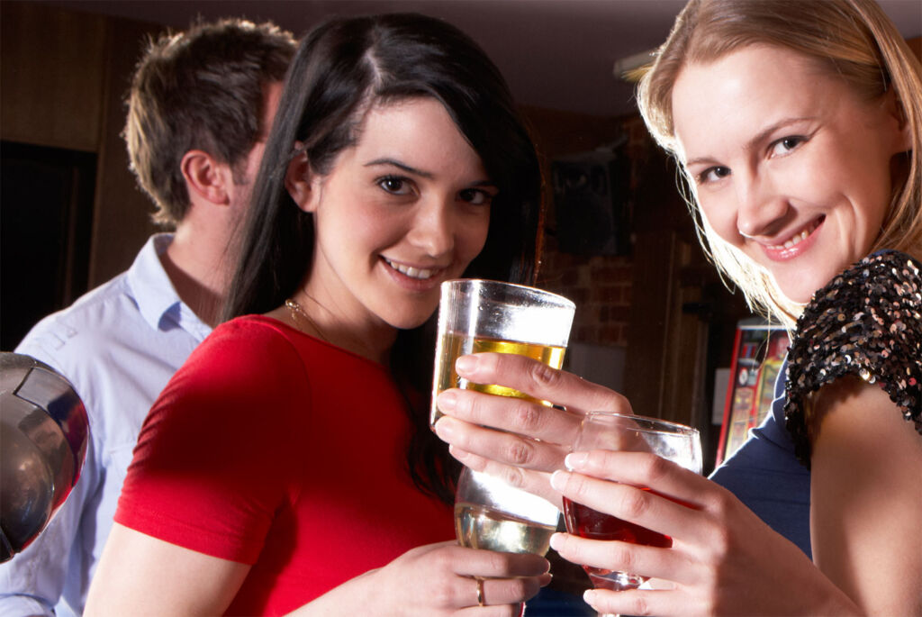 Two ladies enjoying a Christmas drink