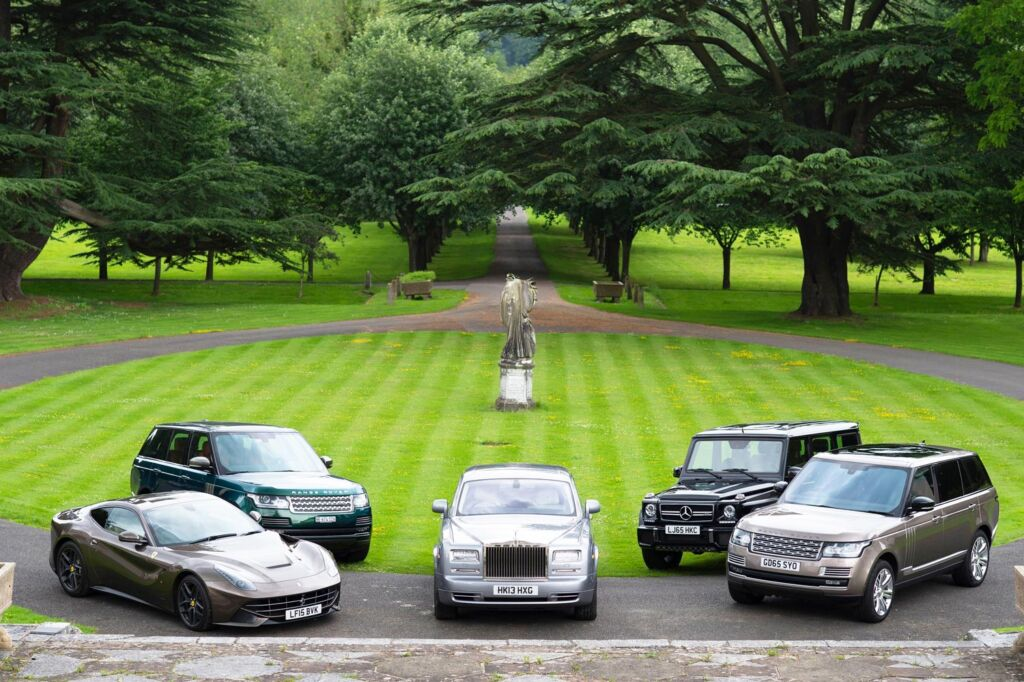 Luxury and sports cars parked in formation at Petworth Park in Sussex