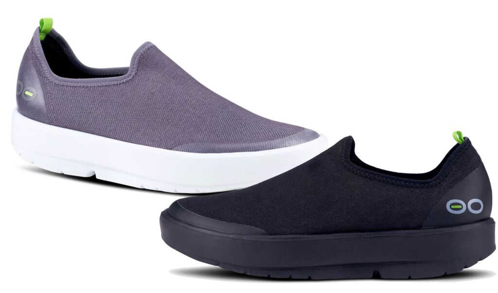 Two of the shoes, one in black and the other in lilac colour