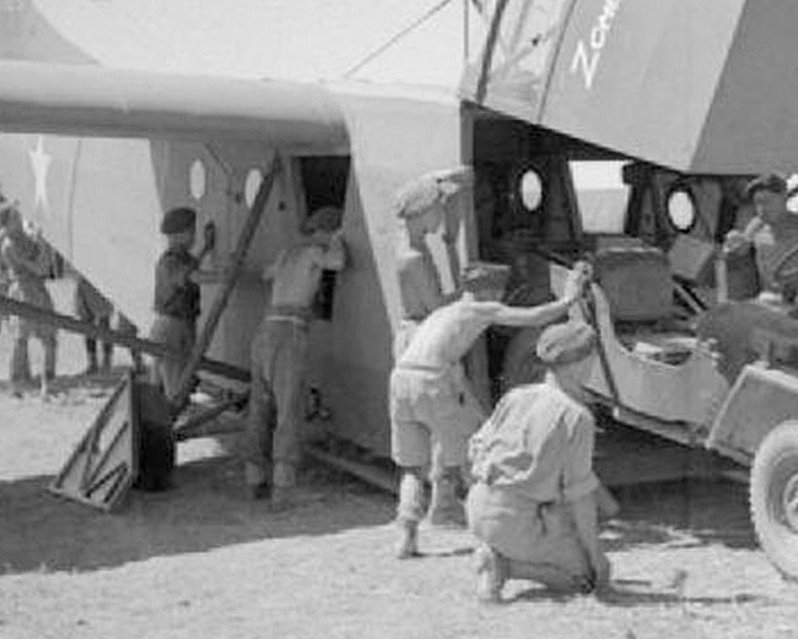Servicemen loading a Waco Glider in WWII