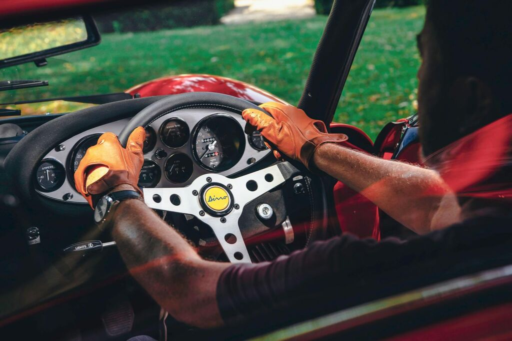 A man driving a red Ferrari Dino courtesy of Atelier Petworth