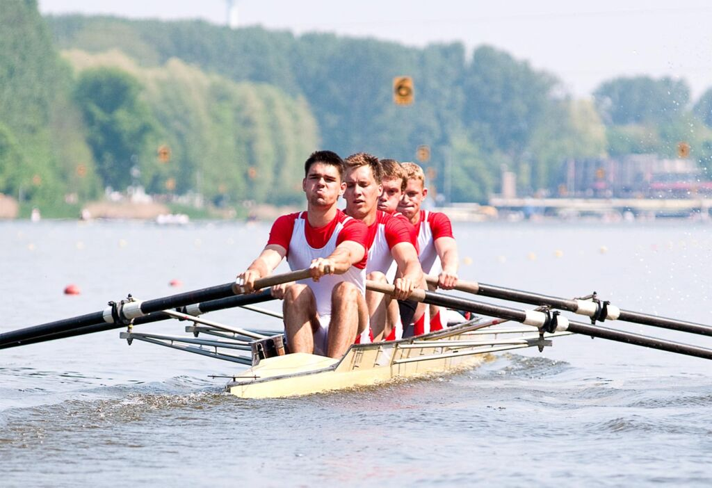 A University rowing team on the water