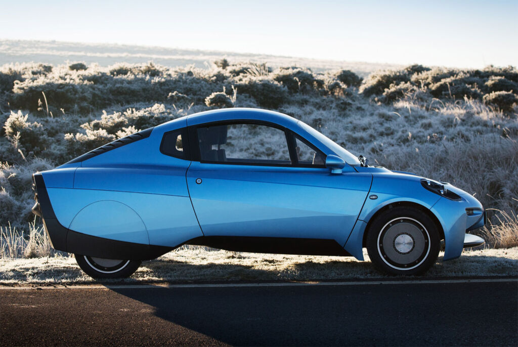A side view of a blue Riversimple RASA Hydrogen powered car