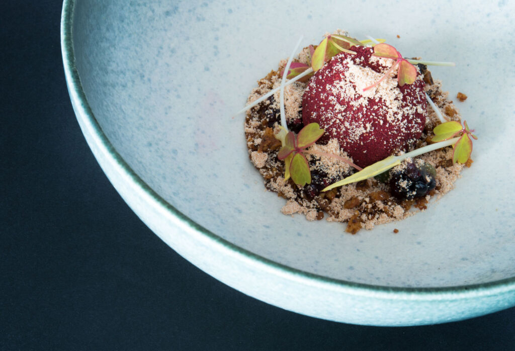 Hedgerow bramble, brown butter crumb, pine.