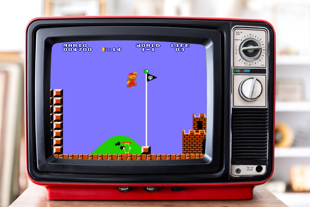 Playing Super Mario Brothers on a retro television set