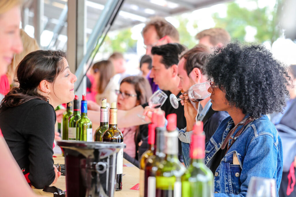 People tasting wines made with Bordeaux red grapes. Photo by G.Bonnaud.