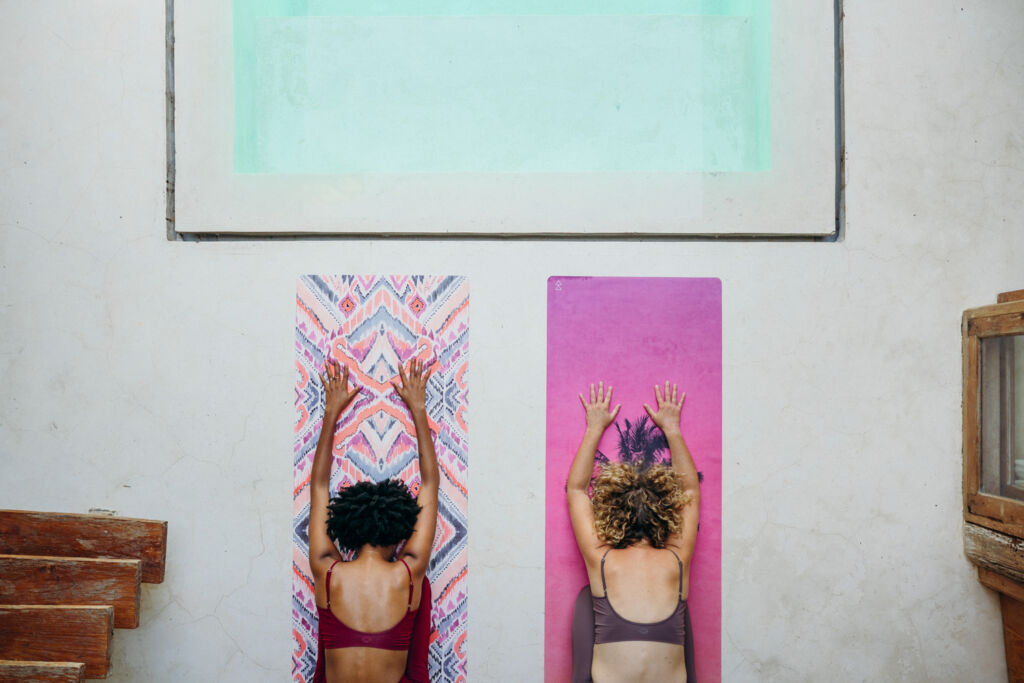 Two women working out on Yoga mats