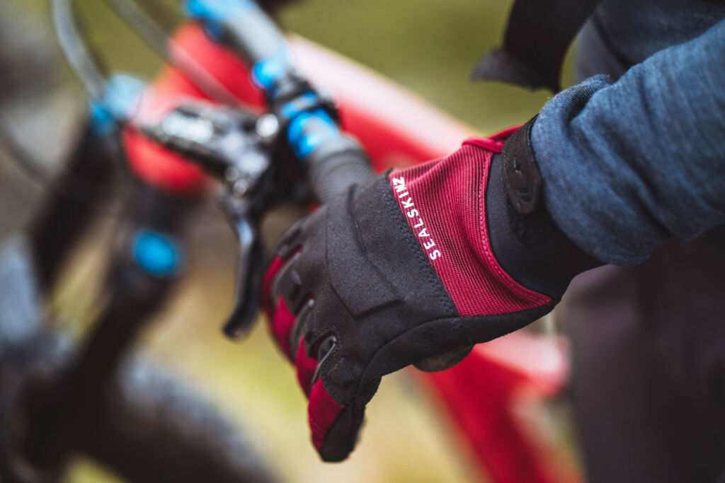 A cycling wearing Sealskinz gloves