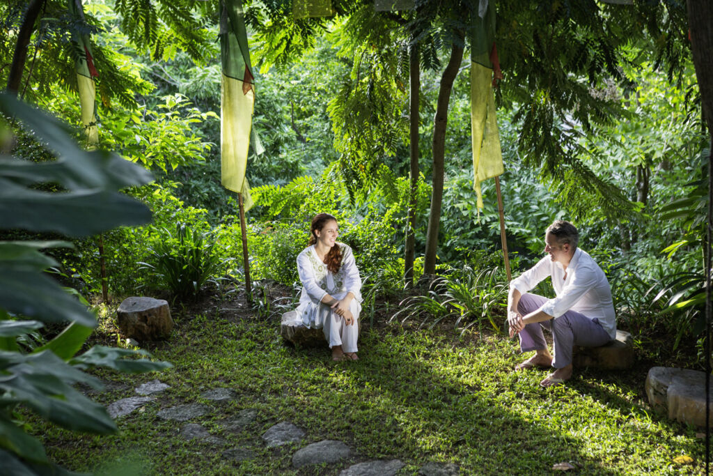 A Man and Woman relaxing and chatting in the tropical jungle. Photo by Thomas Zerlauth